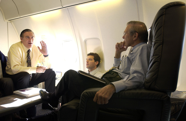 The Honorable Donald H. Rumsfeld (right), U.S. Secretary of Defense, meets with Richard P. Lawless (left), Deputy Assistant Secretary of Defense Asian and Pacific Affairs, and with Larry Di Rita (center), Acting Assistant Secretary of Defense for Public Affairs, aboard a C-32 aircraft en route to Okinawa, Japan on Nov. 16, 2003.(DoD PHOTO by TECH. SGT. Andy Dunaway, U.S. Air Force) (Released)