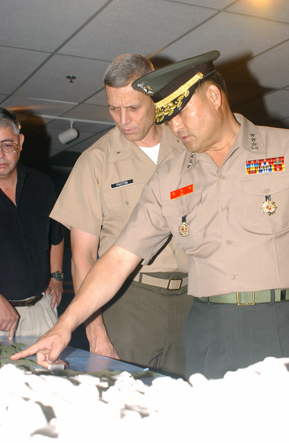 US Marine Corps (USMC) Brigadier General (BGEN) John M. Paxton (left), Commanding General, Marine Corps Recruit Depot/Western Recruiting Region, and Republic of Korea (ROK) Lieutenant General (LGEN) In-Sik Kim (right), Commandant of the ROK Marine Corps, examine a map of the battles that took place during the Korean War, on display at the Marine Corps Recruit Depot Museum, located aboard Marine Corps Recruit Depot (MCRD) San Diego, California (CA)