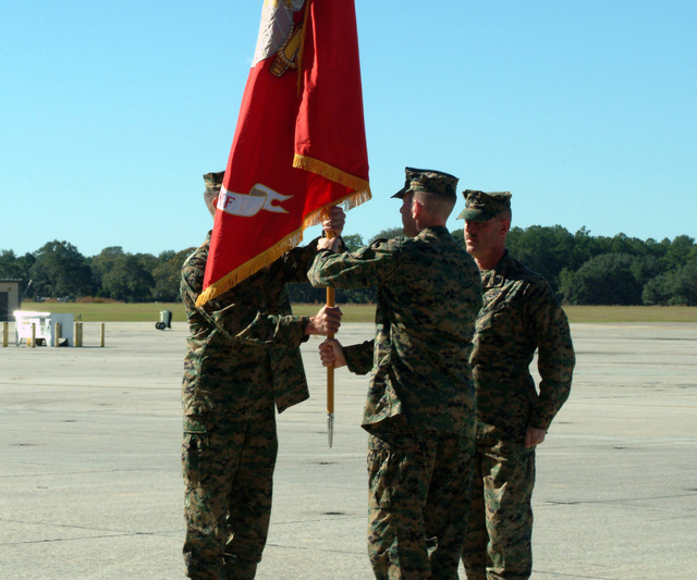US Marine Corps (USMC) Lieutenant Colonel (LTC) Gregg W. Brinegar (left), Out-going Commander, Marine Fighter Attack Squadron One One Five (VMFA-115), passes the Units Colors to USMC LTC Jonathan D. Covington, In-Coming Commander, during the Change of Command Ceremony held at Marine Corps Air Station (MCAS), Beaufort, South Carolina (SC). US Marine Corps (USMC) GUNNERY Sergeant (GYSGT) Darryl Powell, stands in the background