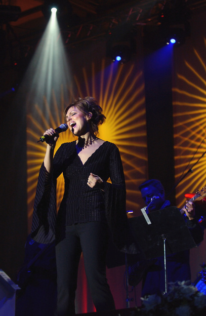 Vocalist, US Air Force (USAF) Captain (CPT) Anita Pavey, Band of the USAF Reserve, performs for military members and their families during the USOs (United Service Organization) Operation Seasons Greetings tour at Ramstein Air Base (AB), Germany