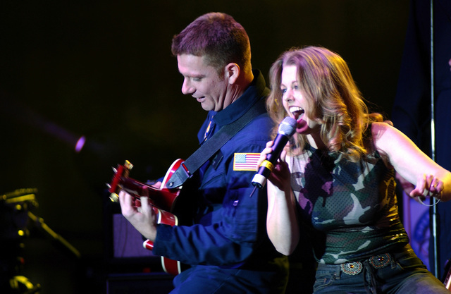 Vocalist US Air Force (USAF) STAFF Sergeant (SSGT) Krista Joyce and guitar player SSGT Gerard Birkenmeier Jr., US Air Forces in Europe Band, performs with the Band of the USAF Reserve during the USOs (United Service Organization) Operation Seasons Greetings tour at Ramstein Air Base (AB), Germany