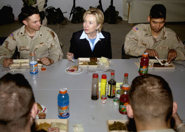 At Kirkuk Air Base (AB), Iraq, New York (NY) Senator Hillary Rodham Clinton (NY-D) has lunch at a US Army (USA) Dining Facility with service members from New York State as part of a CODEL (Congressional Delegation) visit during Operation IRAQI FREEDOM
