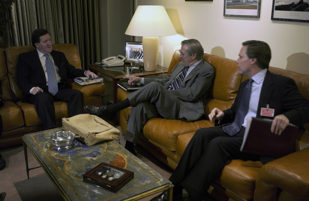 The Honorable Donald H. Rumsfeld (center), U.S. Secretary of Defense, meets with NATO Secretary General George Robertson (left), and the Ambassador to NATO R. Nicholas Burns (right), in Brussels, Belgium, on Dec. 1, 2003. (DoD photo by TECH. SGT. Andy Dunaway) (Released)
