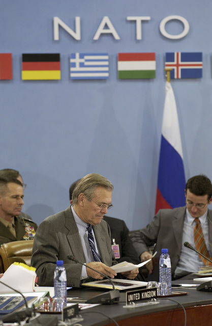 The Honorable Donald H. Rumsfeld, U.S. Secretary of Defense, prepares for a NATO conference in Brussels, Belgium, on Dec. 01, 2003. (DoD photo by TECH. SGT. Andy Dunaway) (Released)