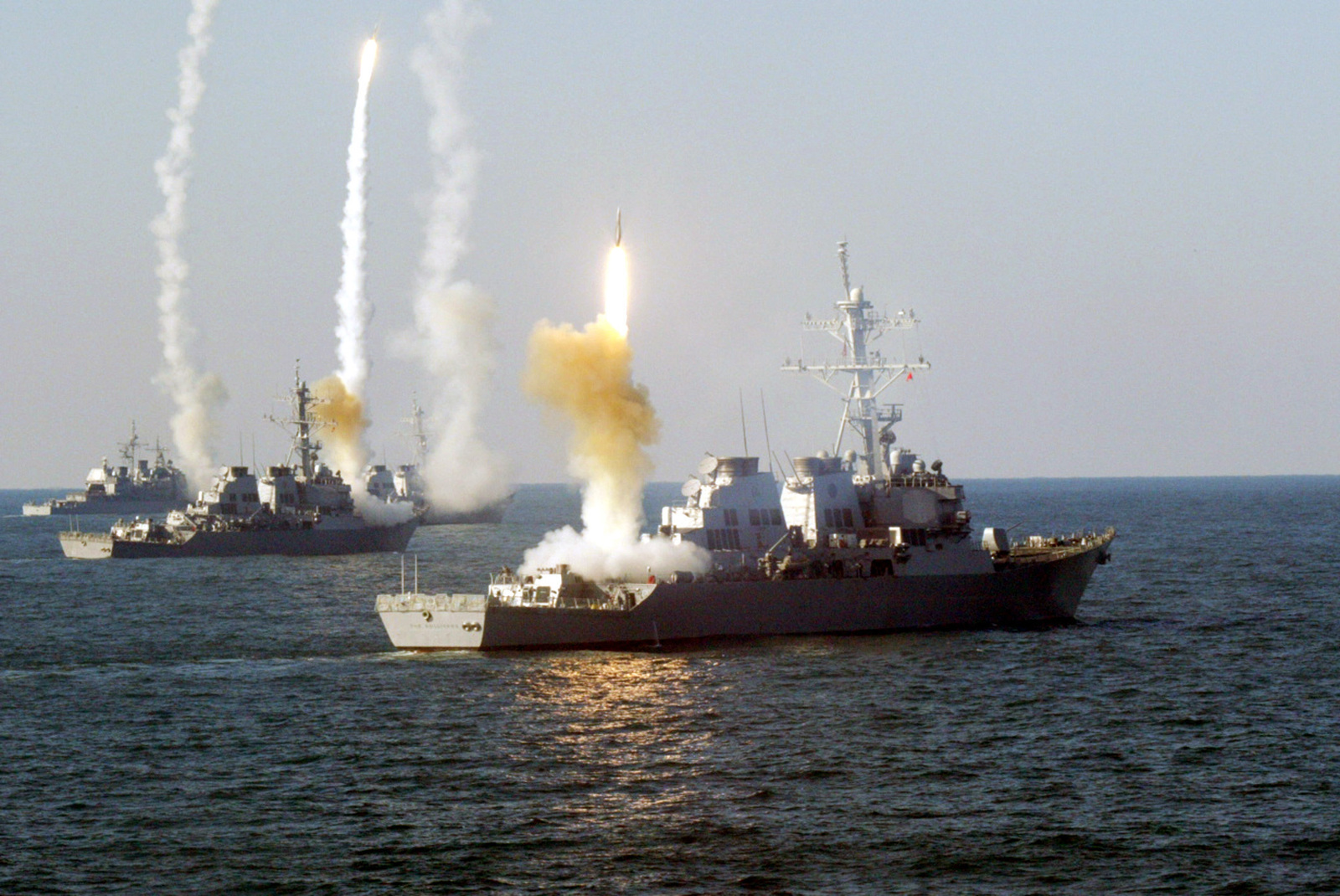 US Navy (USN) Ships launch a coordinated volley of SM-2MR Block II Standard missiles, during a Vandel Exercise (VANDALEX), designed to intercept hostile missiles with ship based missiles during an attack. Remote-controlled drones were used to simulate the hostile missiles. Pictured foreground-to-background are the USN ARLEIGH BURKE CLASS: (Flight I) Guided Missile Destroyer (Aegis), USS THE SULLIVANS (DDG 68), the USS CARNEY (DDG 64), the USN ARLEIGH BURKE CLASS: (Flight IIA) Guided Missile Destroyer (Aegis), USS ROOSEVELT (DDG 80), and the USN TICONDEROGA CLASS: Guided Missile Cruiser (Aegis) USS HUE CITY (CG 66)