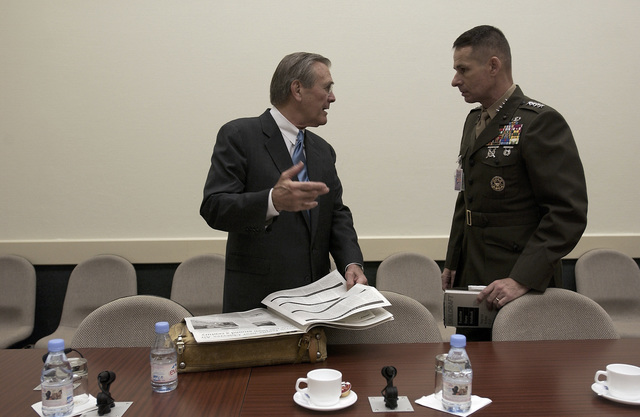 The Honorable Donald H. Rumsfeld (left), U.S. Secretary of Defense, speaks with U.S. Marine Corps, GEN. Peter Pace (right), Vice Chairman of the Joint Chiefs of STAFF, prior to a NATO conference in Brussels, Belgium, on Dec. 2, 2003. (DoD photo by TECH. SGT. Andy Dunaway) (Released)