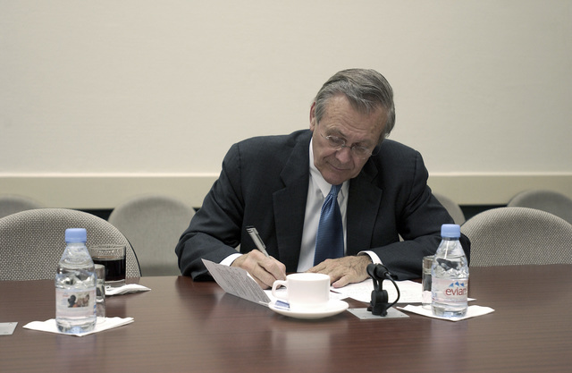 The Honorable Donald H. Rumsfeld, U.S. Secretary of Defense, prepares for a NATO conference in Brussels, Belgium, on Dec. 2, 2003. (DoD photo by TECH. SGT. Andy Dunaway) (Released)