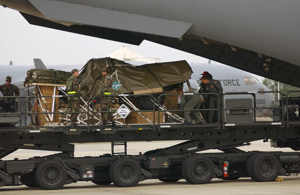 US Army (USA) Soldiers, 82nd Airborne Division (AB DIV), Fort Bragg, North Carolina (NC), assist US Air Force (USAF) Loadmasters, 16th Airlift Squadron (AS), Charleston Air Force Base (AFB), South Carolina (SC), upload a 155mm Howitzer onto a USAF C-17A Globemaster III at Pope AFB, NC. The weapon will be air dropped as part of a multi-ship formation during Large Package week. Large Package week is a joint exercise between the USAF and the USA, designed to enhance interservice cohesiveness