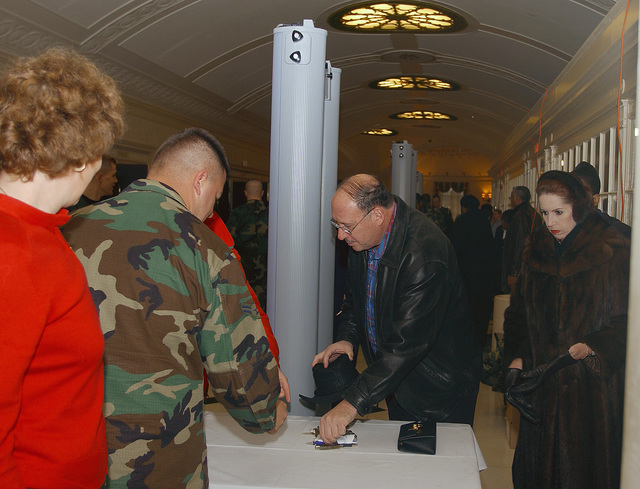 Guests attending the US Air Force (USAF) Band Christmas concert, move through metal detectors at Constitution Hall in Washington, DC