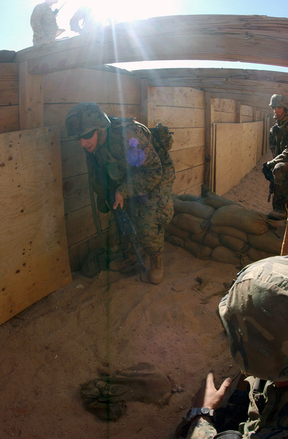 Under the supervision of Instructors, US Marine Corps (USMC) Marines attending the Infantry Officer's Training Course clear enemy trenches at the platoon based trench and grenade range 410A, located at the Marine Air Ground Combat Center, Twentynine Palms, California (CA)