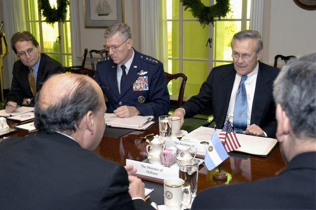 The Honorable Donald H. Rumsfeld, U.S. Secretary of Defense (upper right), Peter Flory (upper left), the Principal Deputy Assistant Secretary of Defense for International Security Affairs, and U.S. Air Force GEN. Richard B. Myers (center), the Chairman of the Joint Chiefs of STAFF, meet with the Minister of Defense Jose Pampuro of the Argentine Republic (lower left), at the Pentagon, Arlington, Va., on Dec. 11, 2003.(DoD photo by Robert D. Ward)  (Released)