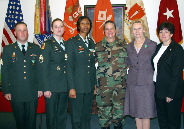 US Army (USA) Brigadier General (BGEN) (P) Janet Hicks (forth from left), Commanding General, US Army Signal School, poses for a group photograph with awards recipients from USA Signal Brigade. Pictured left-to-right: USA Sergeant (SGT) Lloyd, Soldier of the Year; USA STAFF Sergeant (SSG) Smith, Non-Commissioned Officer (NCO) of the Year; USA SSG Starks, Instructor of the Year; BEN Hicks; Judy Wyatt, Civilian of the Year; and Mrs. Guthrie, Volunteer of the Year