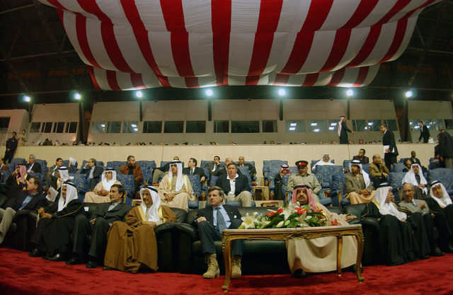Coalition Provisional Authority Administrator, Ambassador L. Paul Bremer (center) and Dr. Mohammed Abdul Ghaffar Abdulla (left), Minister of Foreign Affairs, watch the Iraqi team take part in the third Bahrain International Friendship Soccer Championship for the Prime Minister's Cup at the National stadium in Bahrain during Operation IRAQI FREEDOM