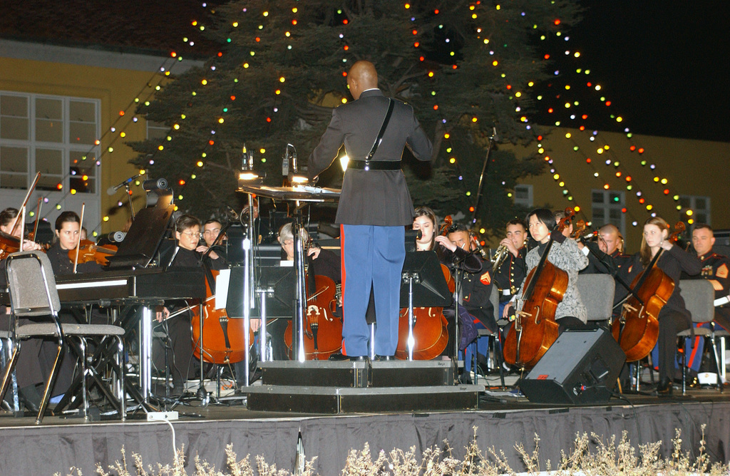 Members of the San Diego Orchestra sit in with the US Marine Corps (USMC) Marine Band San Diego during the Tree Lighting Ceremony Concert aboard the Marine Corps Recruit Depot (MCRD) San Diego, California (CA)