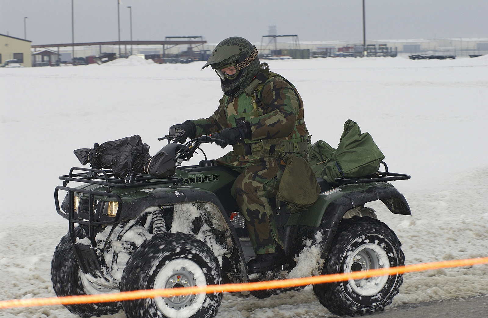US Air Force (USAF) MASTER Sergeant (MSGT) Bart Duggan, Security Forces SPECIALIST, 509th Security Forces Squadron (SFS), patrols the outer perimeter security of the snow covered hot cargo area during a Nuclear Surety Inspection at Whiteman Air Force Base (AFB), Missouri (MO)