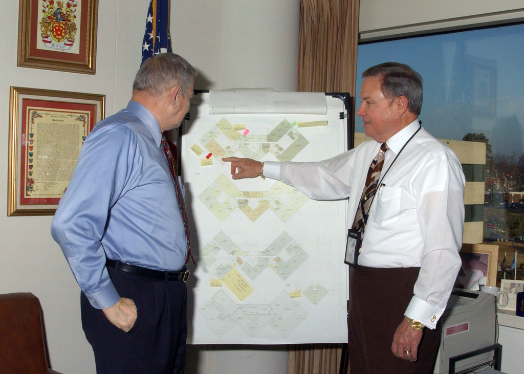 Mr. Charlie Beisel (left), CHIEF Programs Office, Headquarters, Forces Command (FORSCOM), and Mr. Cam Sutherland, Assistant Deputy CHIEF of STAFF, Management for FORSCOM discuss a floor plans diagram at Fort McPherson, Georgia (GA)