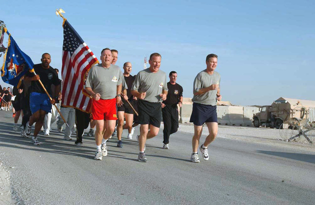"""US Air Force General (GEN) John P. Jumper (left), CHIEF of STAFF of STAFF of the Air Force (CSAF), leads a 1.5 mile run with USAF Colonel (COL) Jack Eggington, Commander, 379th Air Expeditionary Wing (AEW), and CHIEF MASTER Sergeant of the Air Force (CMSAF) Gerald Murray (right) at an undisclosed location in Southwest Asia during Operation IRAQI FREEDOM. The """"Fight to Fit"""" run promoted fitness for the 379th AEW members"""
