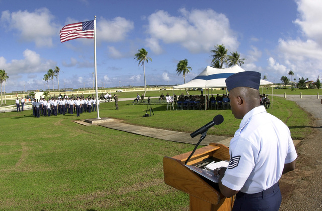 US Air Force (USAF) Technical Sergeant (TSGT) John Lester, 36th Mission Support Squadron (MSS), reads the names of the 33 Airmen killed during the Linebacker II Campaign as part of the ceremony held at Andersen Air Force Base (AFB), Guam. In the formation, beyond the flag, 33 members from Andersen's Network 56, an organization for STAFF and Technical Sergeants, representing the 33 airmen killed during the Campaign. As each name is called a member of the formation comes to attention to representing that person