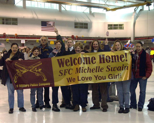 Family and friends of US Army (USA) SPECIALIST First Class (SFC) Michelle Swain wait eagerly for her arrival home. SFC Swain and other members of the 323rd Military Police Company (MPC) deployed overseas for nearly one year in support of Operation ENDURING FREEDOM
