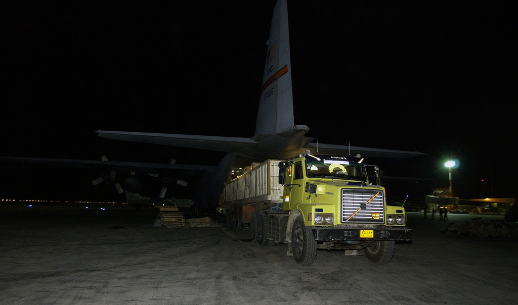 A US Central Air Forces (CENTAF) US Air Force (USAF) C-130 Hercules, 182nd Airlift Wing (AW), Illinois Air National Guard (ILANG), offloaded by USAF crewmembers and Iranian Soldiers onto a truck at Kerman, Iran. Some five pallets containing 20 thousand pounds of medical supplies are delivered two days after a devastating earthquake destroyed the city of Bam, Iran