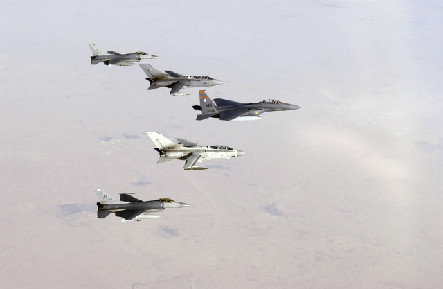 A US Air Force (USAF) F-15E Strike Eagle, 391st Fighter Squadron (FS), Mountain Home Air Force Base (AFB), Idaho (ID), leads a formation of two Royal Air Force (RAF) GR4 Tornadoes, No. 617th Squadron, RAF Lossiemouth, United Kingdom (UK), and two F-16CG-40D Fighting Falcons, 510th Fighter Squadron, Aviano Air Base (AB), Italy (ITA). The airframes and crews deployed to the area in support of Operation IRAQI FREEDOM