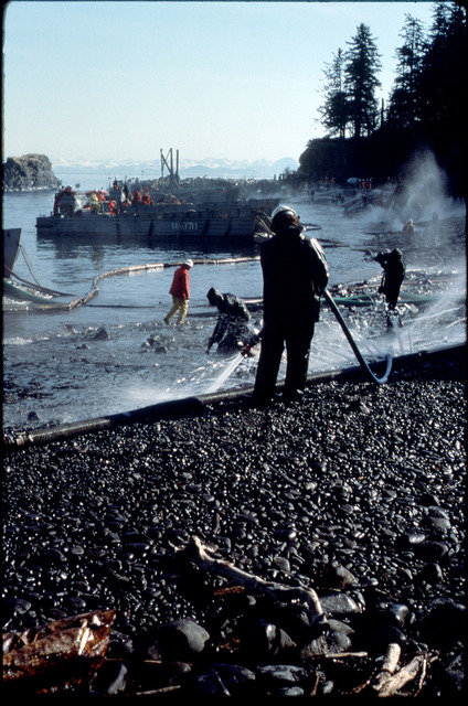 Library of Environmental Images, Office of Research and Development (ORD), September 1996 - Hazardous Waste - Workers using high-pressure spray to clean up spilled oil (AK)