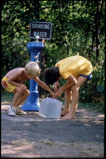 Library of Environmental Images, Office of Research and Development (ORD), September 1996 - Water - Children filling water jug at water fountain