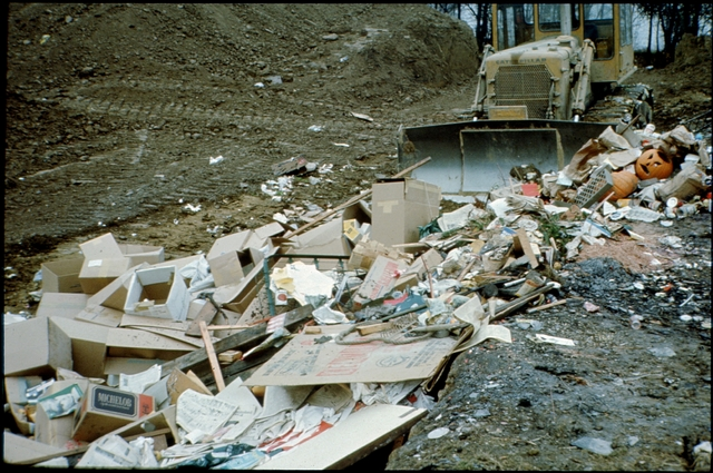 Library of Environmental Images, Office of Research and Development (ORD), September 1996 - Pollution Prevention - Bulldozer pushing garbage in landfill
