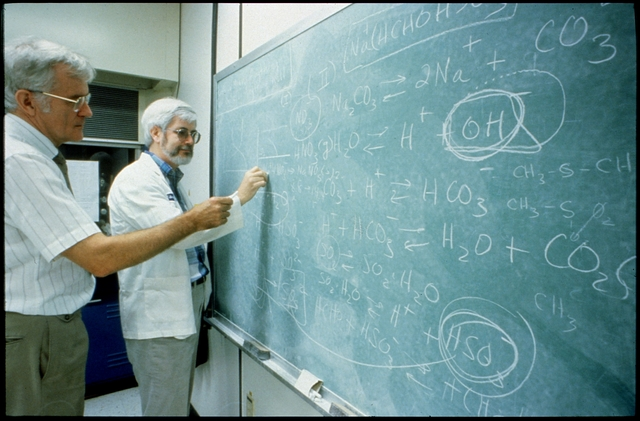 Library of Environmental Images, Office of Research and Development (ORD), September 1996 - Environmental Technology - EPA scientists analyzing formulas on chalkboard