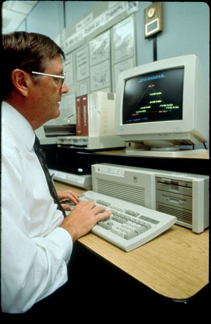 Library of Environmental Images, Office of Research and Development (ORD), September 1996 - Environmental Technology - Scientist analyzing data on computer screen