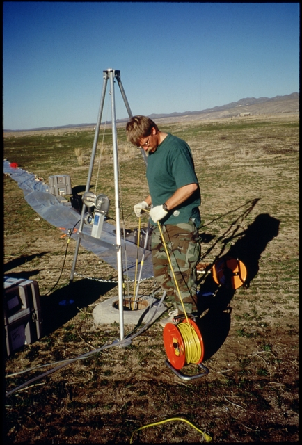 Library of Environmental Images, Office of Research and Development (ORD), September 1996 - Environmental Technology - Geologist studying flow pattern within a monitoring well