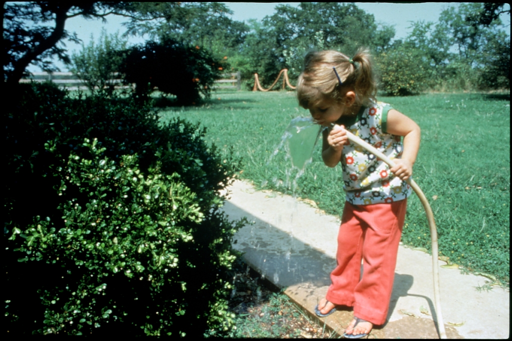 Library of Environmental Images, Office of Research and Development (ORD), September 1996 - Water - Child drinking from garden hose