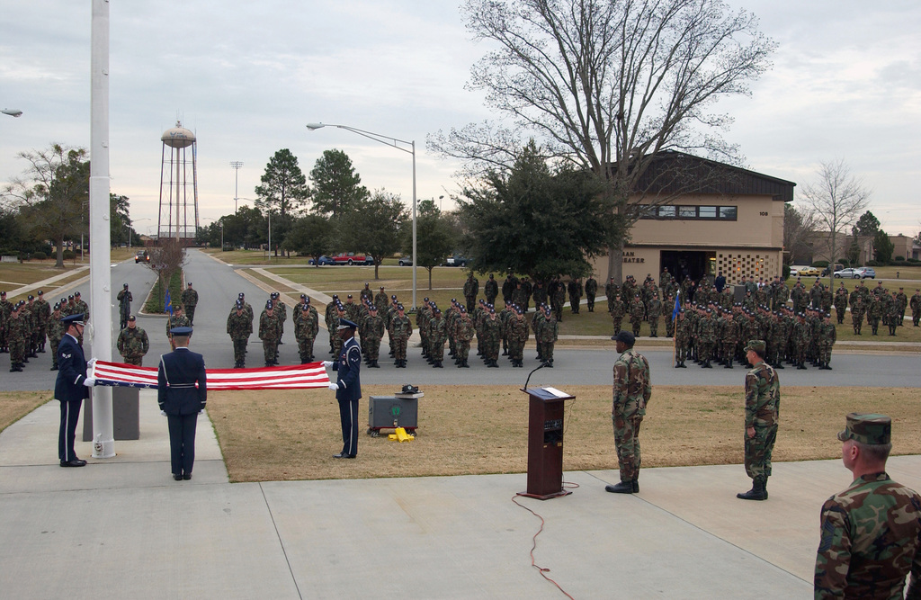 Honor Guard members from the US Air Force (USAF) 347th Rescue Wing (RW), Moody Air Force Base (AFB), Georgia (GA), fold the flag during memorial ceremony retreat, for a fallen AIRMAN. On December 27th 2003, while visiting his father in Houston Texas, AIRMAN First Class (A1C) Kevin A. Kerry, of the 347th Aircraft Maintenance Squadron (AMS), was killed in an automobile accident