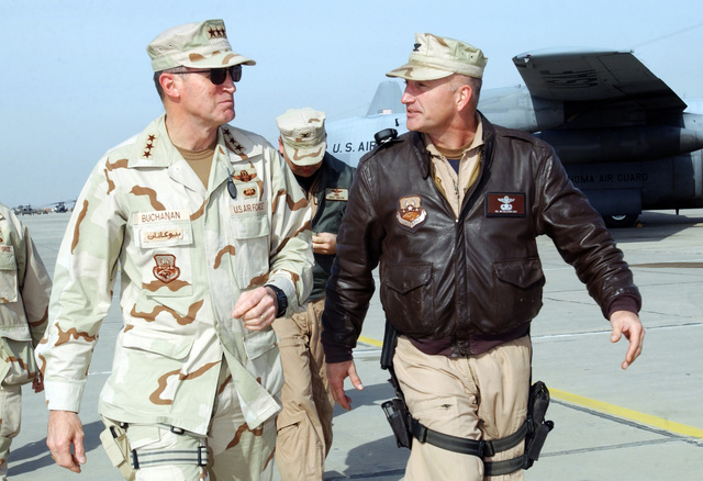 US Air Force (USAF) Lieutenant General (LGEN) Walter Buchanan (left), Commander, US Central Command USCENTCOM, Air Forces, speaks with USAF) Colonel (COL) James Callahan, Group Commander, 447th Air Expeditionary, at Baghdad International Airport (BIAP), Iraq. As they walk along the ramp COL Callahan briefs LGEN Buchanan on a C-5 Galaxy that underwent an in-flight emergency when the aircraft was apparently hit by a missile as it took off from BIAP, Iraq, the day prior. USAF LGEN Buchanan is visiting BIAP in support of Operation IRAQI FREEDOM