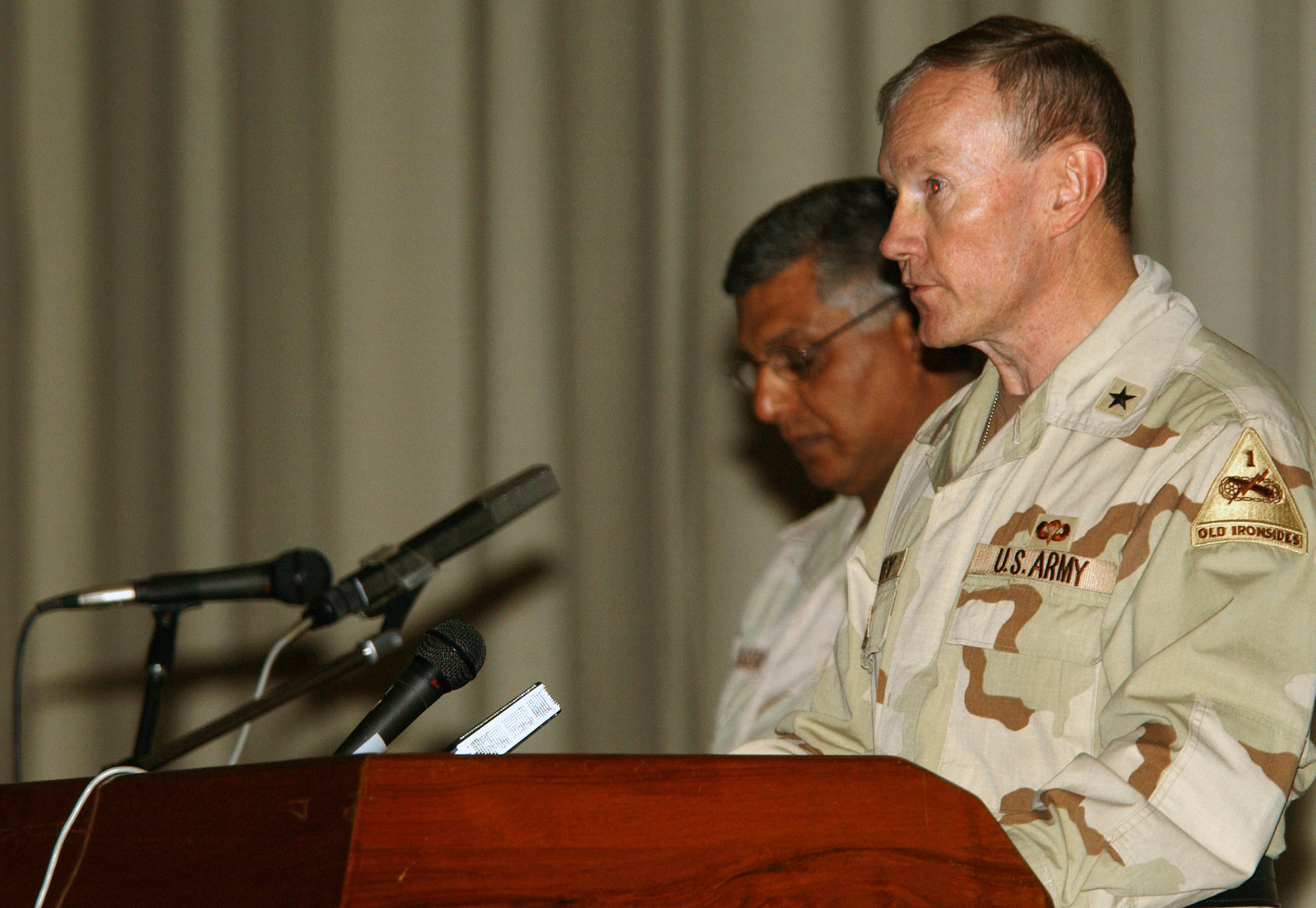 US Army (USA) Brigadier General (BGEN) Martin E. Dempsey, 1ST Armored Division (AD), gives a few remarks to the Iraqis who served unselfishly during previous wars in Iraq at a recognition ceremony held in the Convention Center in Baghdad, Iraq, during Operation IRAQI FREEDOM. They are being given recognition for past bravery to show they will be recognized for future bravery under the new Iraqi government. Since the end of major combat operations, the Iraqi Police Service (IPS), Facility Protection Service (FPS), and Iraqi Civil Defense Corps (ICDC) worked to hire, train, equip, and employ personnel throughout the city in a profession that often requires selfless service, sacrifice, and...