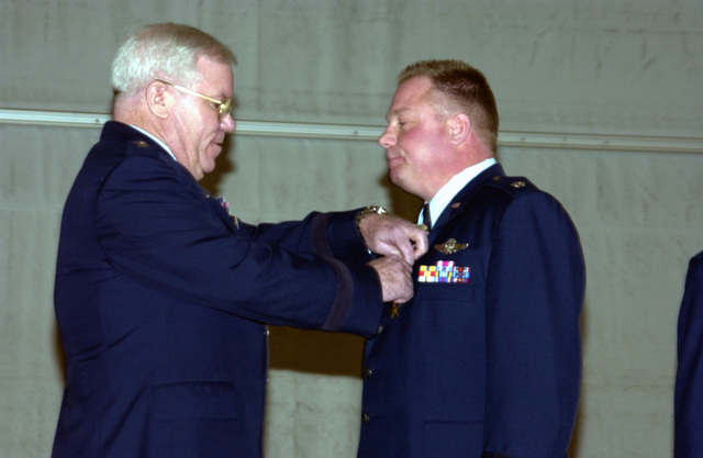 """US Air Force (USAF) Major General (MGEN) Thomas P. """"Tommy"""" Maguire Jr., Adjutant General of New York State and Commander 487th Air Expeditionary Wing (AEW) awards the Bronze Star to USAF Lieutenant Colonel (LTC) James F. Atkinson III, 107th Air Refueling Wing (ARW), New York Air National Guard (NYANG), New York (NY), at the Niagara Falls Air Reserve Station. LTC Atkinson then Commander 487th AEW Maintenance Squadron received his award for his outstanding accomplishments when mobilized for Operation IRAQI FREEDOM"""
