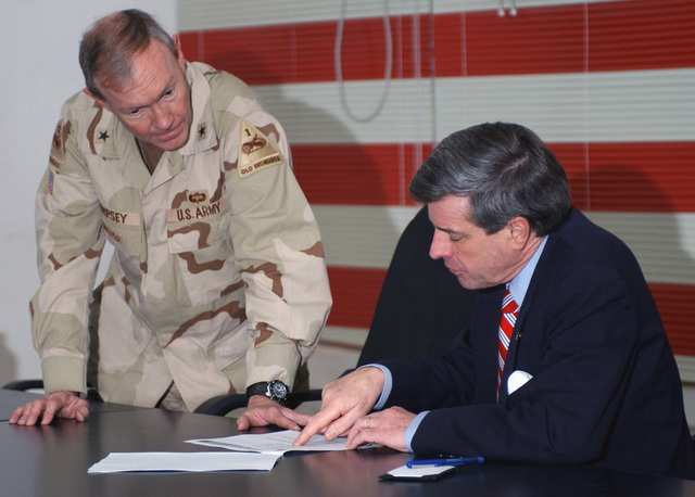 Coalition Provisional Authority Administrator (CPAA), Ambassador L. Paul Bremer is briefed by US Army (USA) Brigadier General (BGEN) Martin E. Dempsey, 1ST Armored Division (AD), about plans for renovation of the Iraq Civil Defense Corps (ICDC) Academy and training during Operation IRAQI FREEDOM