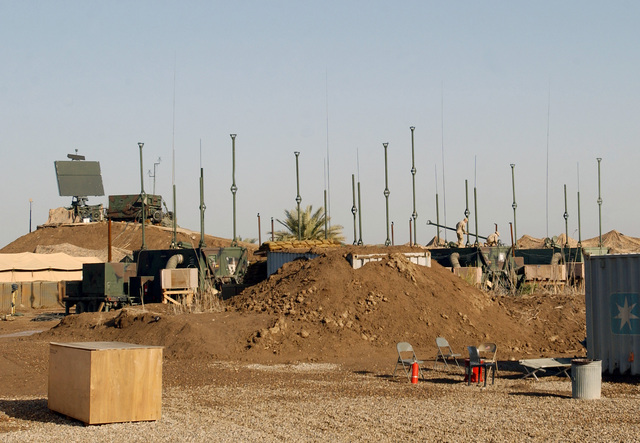 US Air Force (USAF) 447th Expeditionary Air Control Squadron (EACS) Surveillance Technicians maintain antennas on Camp Griffin at Baghdad International Airport (BIA), Iraq, in support of Operation IRAQI FREEDOM