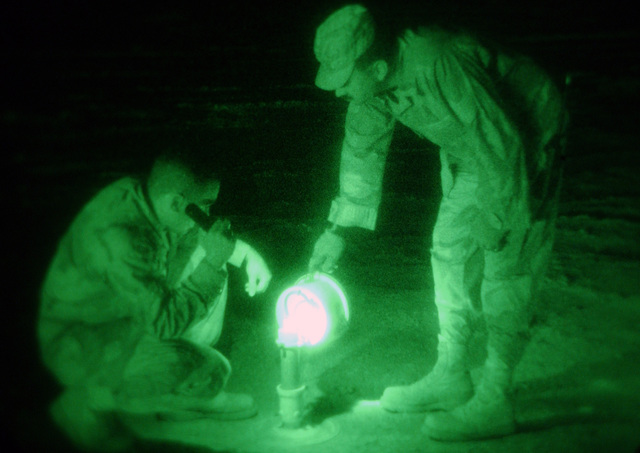 US Air Force (USAF) AIRMAN First Class (A1C) David Eiler, left and Technical Sergeant (TSGT) Cameron Hess, with the 447th Expeditionary Civil Engineer Squadron (ECES), Airfield Lighting Electricians, maintain runway lights for all of Baghdad International Airport (BIA), Iraq, in support of Operation IRAQI FREEDOM