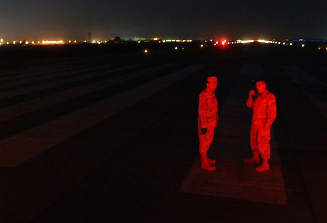 US Air Force (USAF) Technical Sergeant (TSGT) Cameron Hess and AIRMAN First Class (A1C) David Eiler, left, with the 447th Expeditionary Civil Engineer Squadron (ECES), Airfield Lighting Electricians, maintain runway lights for all of Baghdad International Airport (BIA), Iraq, in support of Operation IRAQI FREEDOM
