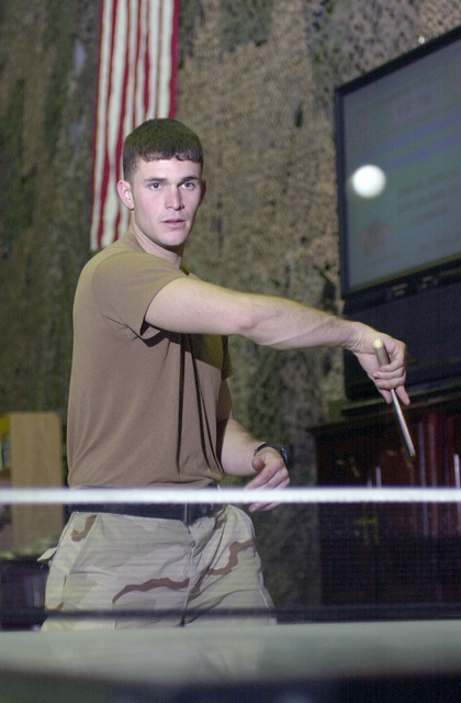 US Army (USA) Sergeant (SGT) Adam Covington, a team leader with the 101st Airborne Division, Fort Campbell, Kentucky (KY), hones his table tennis skills at Incirlik Air Base (AB), Turkey (TUR), while he waits for a flight home after serving a tour in Iraq