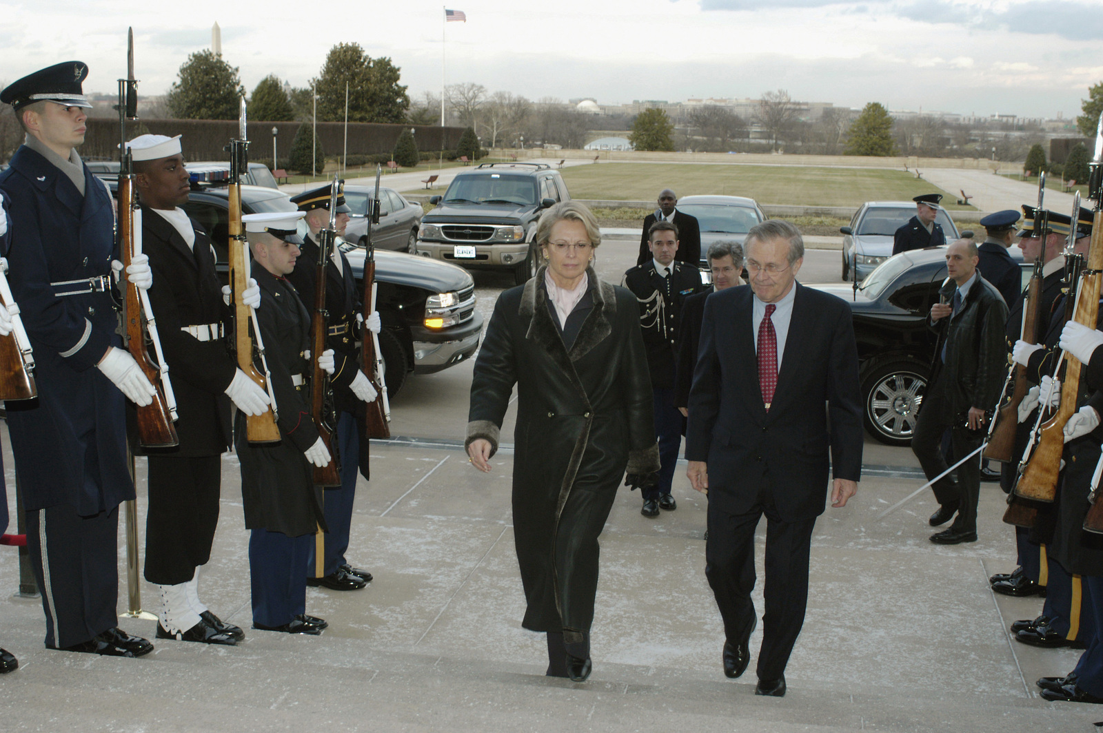 The Honorable Donald H Rumsfeld U S Secretary Of Defense Escorts Frances Minister Of Defense Michelle Alliot Marie Into The Pentagon Where They Are