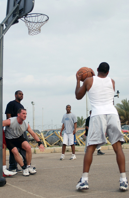 US Air Force (USAF) Airmen of the 447th Air Expeditionary Group (AEG), stationed at Baghdad International Airport (BIA), enjoy a game of basketball during Sports Day in Iraq, during Operation IRAQI FREEDOM