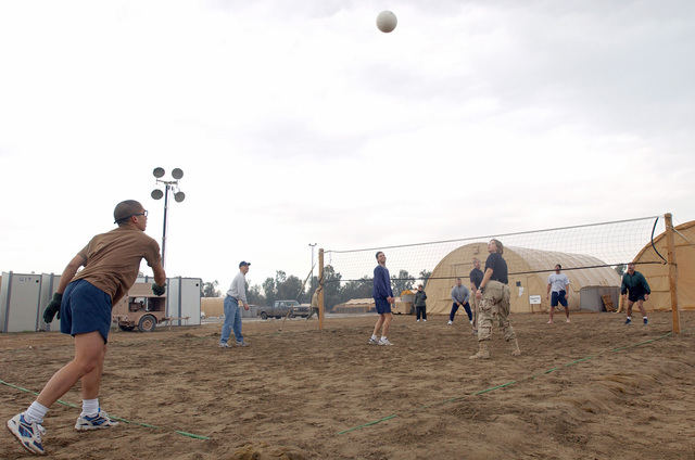 US Air Force (USAF) Airmen of the 447th Air Expeditionary Group (AEG), stationed at Baghdad International Airport (BIA), enjoy a game of volleyball during Sports Day in Iraq, during Operation IRAQI FREEDOM