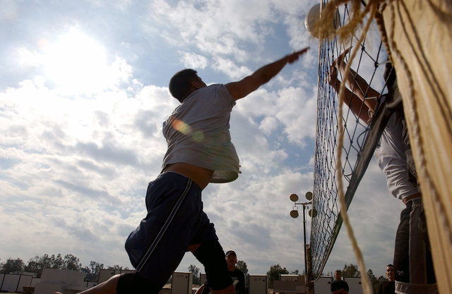 US Air Force (USAF) Technical Sergeant (TSGT) Glen Primero, Primero displays his volleyball prowess during the 447th Air Expeditionary Group (AEG) Sports Day at Baghdad International Airport (BIA), during Operation IRAQI FREEDOM