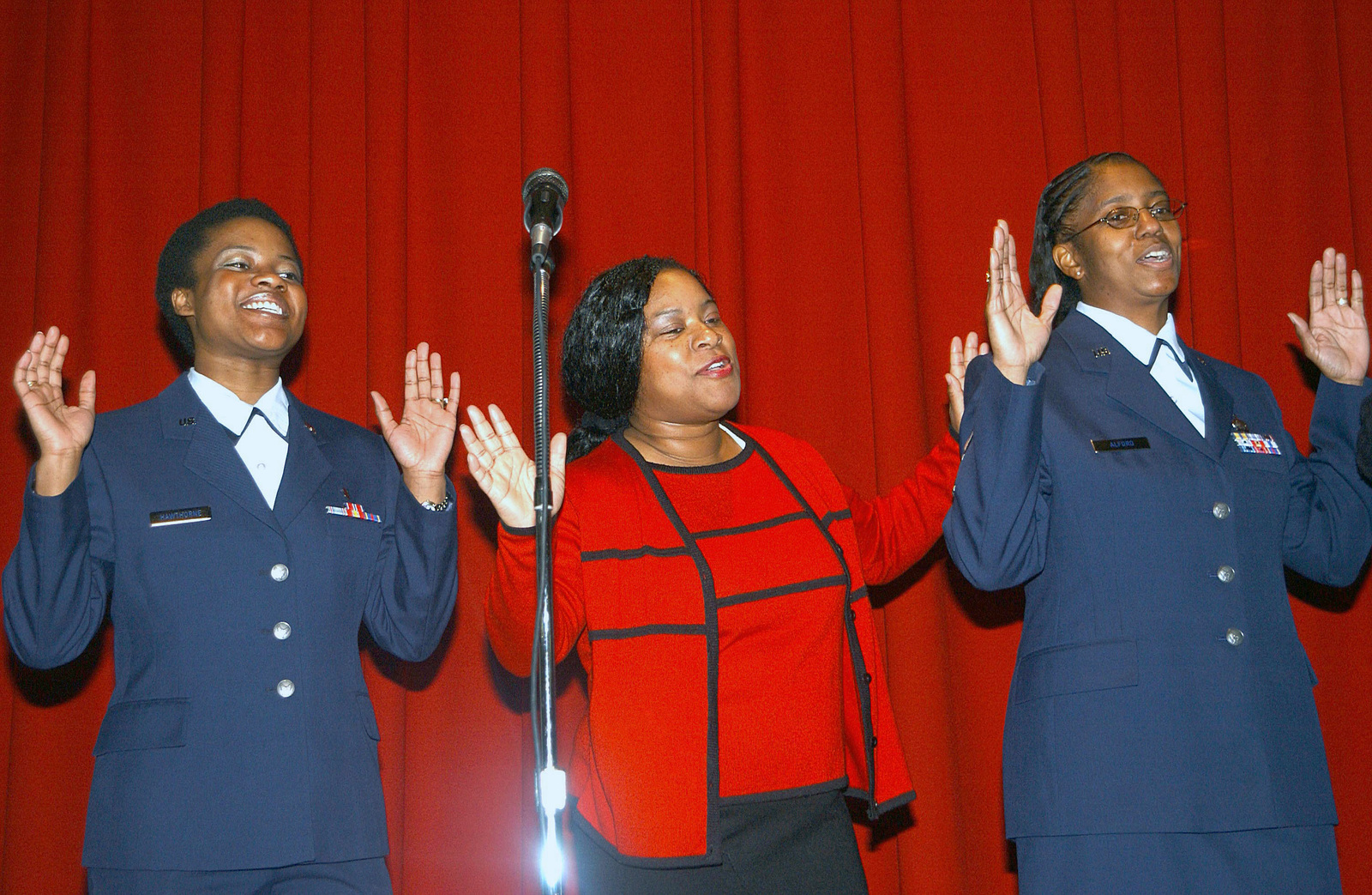US Air Force (USAF) SENIOR AIRMAN (SRA) Chemika Hawthorn, with the 92nd Medical Group (MG), Civilian Marion Williams and MASTER Sergeant (MSGT) Dannie Alford of the Civil Engineering Squadron (CES), at Fairchild Air Force Base (AFB), Washington (WA), perform in a gospel choir at a luncheon honoring the late Dr. Martin Luther King, Jr