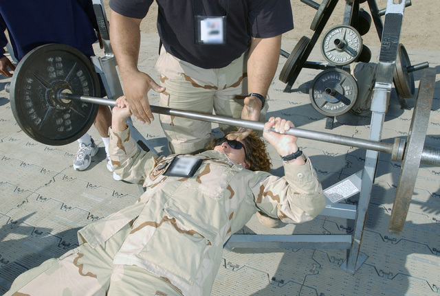 US Air Force (USAF) Major (MAJ) Tamara Rogers, the 447th Expeditionary Services Squadron (ESS) Commander, bench presses her way to victory in the women's category for the bench press competition at Baghdad International Airport (BIA), Iraq, during Operation IRAQI FREEDOM