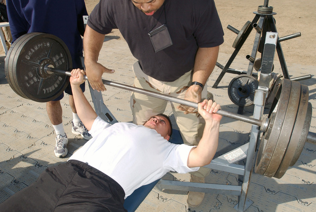 US Army (USA) Private First Class (PFC) Randy Zarate, with the 297th Transportation Brigade (TB), presses his way to victory in a bench press competition at Baghdad International Airport (BIA), Iraq, during Operation IRAQI FREEDOM