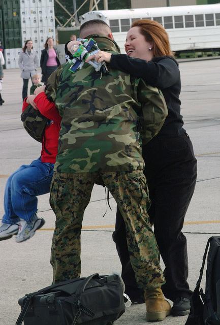 US Marine Corps (USMC) GUNNERY Sergeant (GYSGT) Alistair Ortiz, Marine All Weather Fighter Attack Squadron 224 (VMFA(AW)-224), welcomed back to Marine Corps Air Station (MCAS) Beaufort, South Carolina (SC), by his wife, Michelle and son, Alistair Jr., after a routine six-month deployment