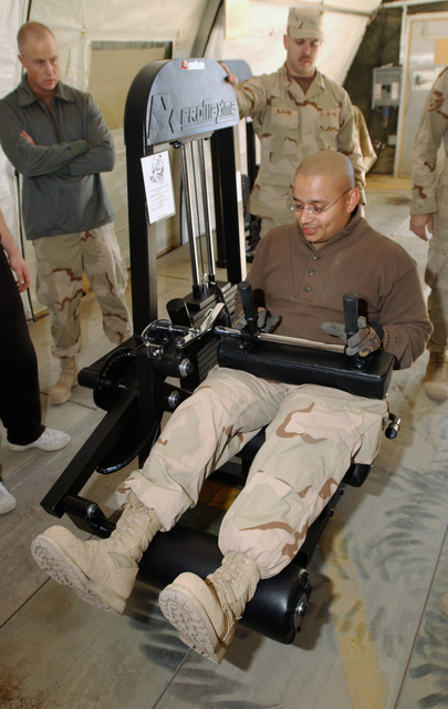 US Air Force (USAF) STAFF Sergeant (SSGT) Robert Gonzalez, with the 447th Expeditionary Services Squadron (ESS), tries out new fitness equipment in the new fitness center at Baghdad International Airport (BIA), Iraq, in support of OPERATION IRAQI FREEDOM